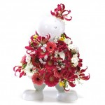 Vaso a forma di omino, di design pieno di fioi