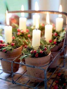 Vasi porta candele con vasi e rami