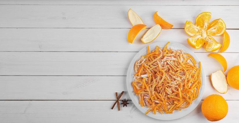 Scorze d'arancia candite con zucchero a velo